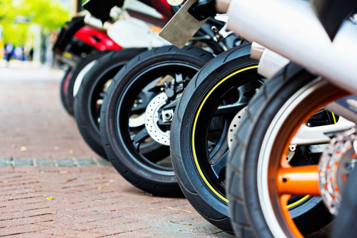 Paving Stone「Motorbikes with a variety of tyres lined up on forecourt」:スマホ壁紙(13)