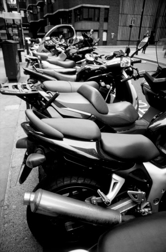 Motorcycle「Motorbikes and scooters parked on the sidewalk (black and white)」:スマホ壁紙(3)