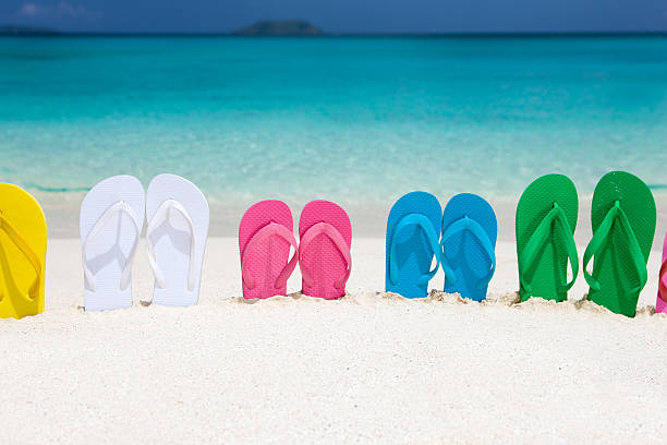 colorful family sandals in a sand at the Caribbean beach:スマホ壁紙(壁紙.com)