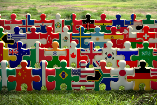 Cooperation「Puzzles of national flags holding hands in a row」:スマホ壁紙(18)