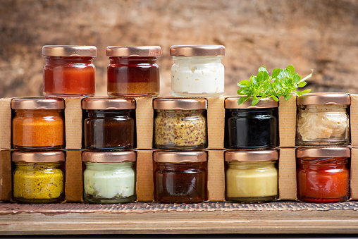Soy Sauce「Large collection of sauces and spiced spreads in small jars on a shelf」:スマホ壁紙(12)