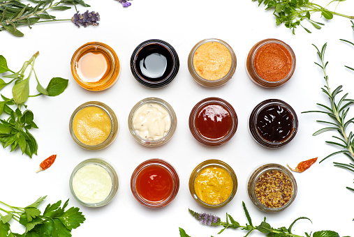 Condiment「Large collection of sauces and spiced spreads in small jars isolated flat lay」:スマホ壁紙(4)
