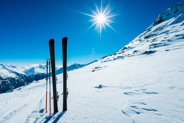 Skis and ski poles on remote slope:スマホ壁紙(壁紙.com)
