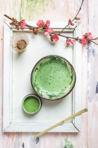 Cherry Blossom「Matcha tea in bowl, with match powder, spoon and chasen and pink flowers」:スマホ壁紙(10)