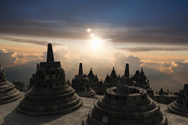 Spires on Temple of Borobudur at sunset, Borobudur, Indonesia:スマホ壁紙(壁紙.com)