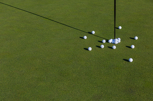 Taking a Shot - Sport「Multiple golf balls on putting green.」:スマホ壁紙(7)