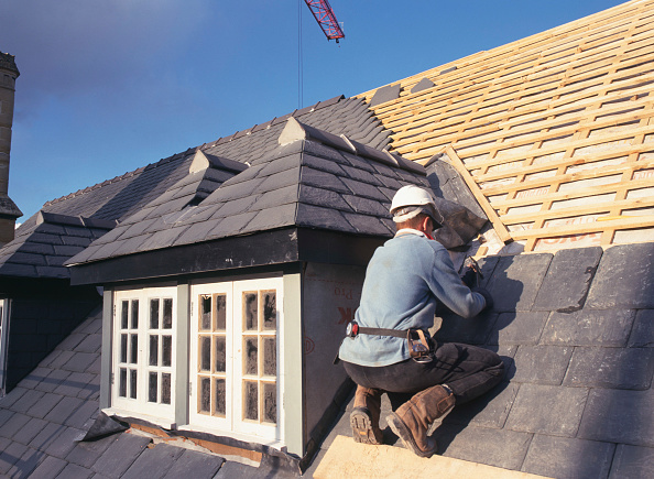 Repairing「Cardiff, Conversion of 16th century Grade II listed country house to luxury apartments.  Re-roofing work in progress, fixing roof slates around dormer windows.」:写真・画像(7)[壁紙.com]