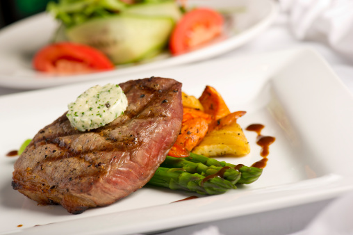 Herb Sauce「A white square plate containing grilled steak and salad」:スマホ壁紙(8)