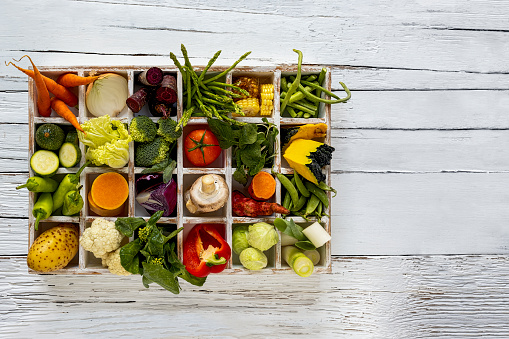 Pigeon Hole「Many rustic, colorful, market fresh and organic healthy vegetables in compartments in a white wooden box tray on an old weathered white wooden paneled table top background.」:スマホ壁紙(16)
