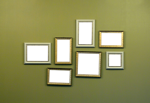 Old-fashioned「Collage of empty picture frames hanging on wall」:スマホ壁紙(6)