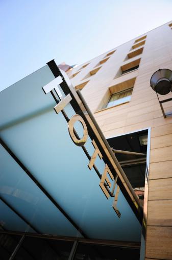 Motel「Hotel sign over building entrance」:スマホ壁紙(16)