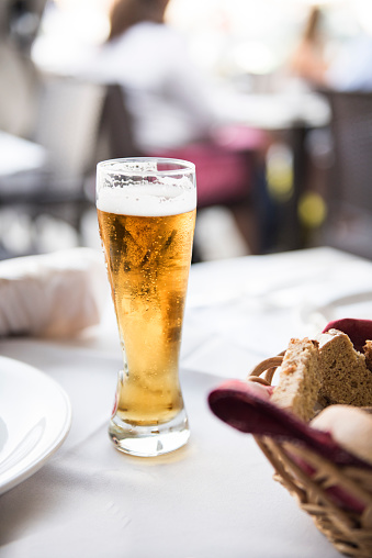 Meal「Glass of beer on a table at lunch」:スマホ壁紙(8)