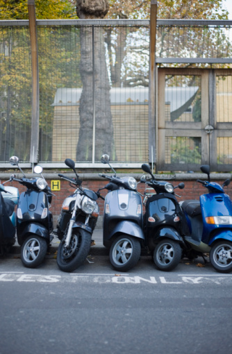Motorcycle「Row of parked motorized scooters」:スマホ壁紙(7)