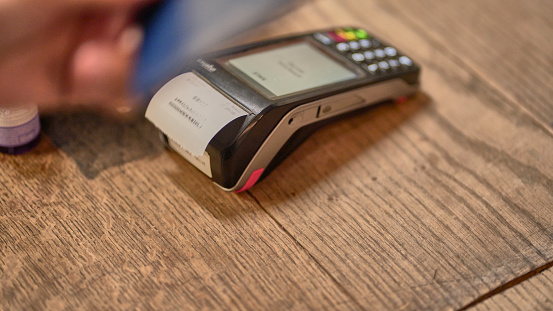 Credit Card Purchase「A young woman hand using a contact less payment card and machine」:スマホ壁紙(18)