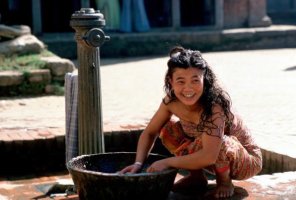 Simplicity「Woman Washing at Water Pump, Nepal」:写真・画像(4)[壁紙.com]