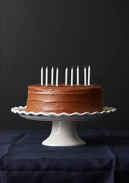 Studio shot of chocolate birthday cake:スマホ壁紙(壁紙.com)