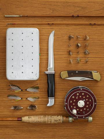 Fishing「Studio shot of flyfishing equipment on wooden table」:スマホ壁紙(15)
