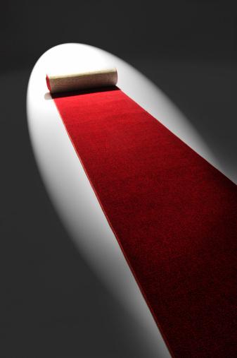 Rolling「Studio shot of rolling out red carpet」:スマホ壁紙(6)