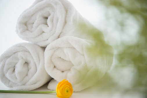 Relaxation「Studio Shot of rolled up towels with yellow flower」:スマホ壁紙(14)
