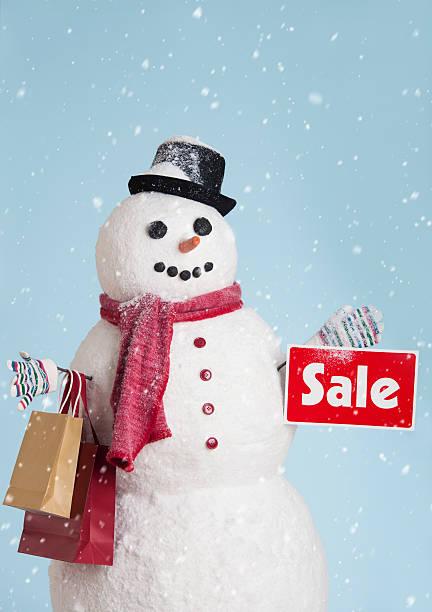 Studio shot of snowman with shoppings:スマホ壁紙(壁紙.com)