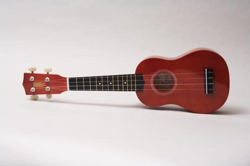 Ukelele「Studio shot of an ukulele laying on a white background.」:スマホ壁紙(6)