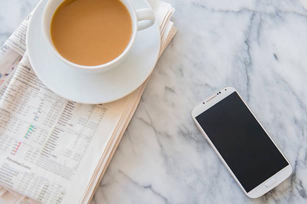 Studio shot of coffee cup, newspaper and smart phone:スマホ壁紙(壁紙.com)