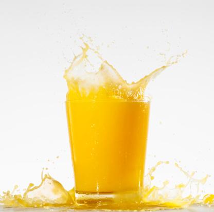 Orange juice「Studio shot of orange juice with splash」:スマホ壁紙(4)