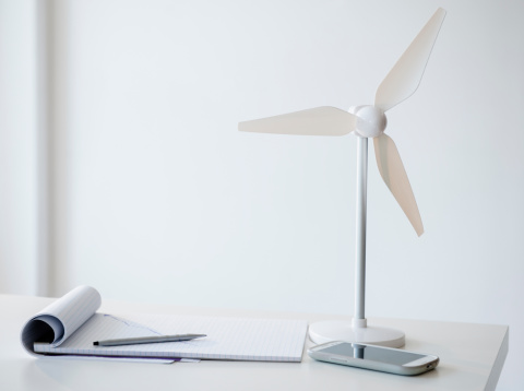 Efficiency「Studio Shot of small wind turbine, mobile phone and note pad on desk」:スマホ壁紙(13)