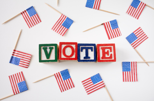Election「Studio shot of small american flags and wooden blocks with text VOTE」:スマホ壁紙(5)