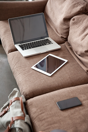Portability「Laptop, tablet and smartphone on couch」:スマホ壁紙(12)