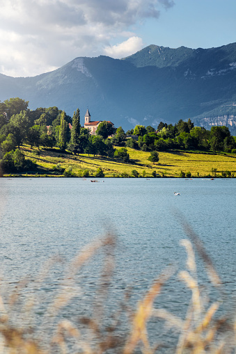 Bugey「French landscape with small church steeple along Rhone river and Grand Colombier Bugey Alps mountains in summer in Auvergne-Rhone-Alpes」:スマホ壁紙(12)