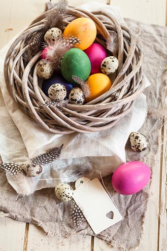 イースター「Colourful Easter eggs and quail eggs in rustic nest」:スマホ壁紙(11)