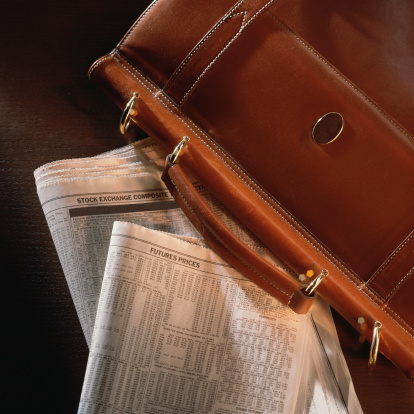 Briefcase「Briefcase on top of newspaper stock listings」:スマホ壁紙(7)