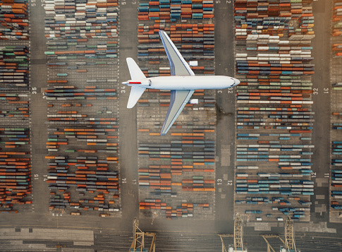 Pier「Airplane flying over container port」:スマホ壁紙(6)