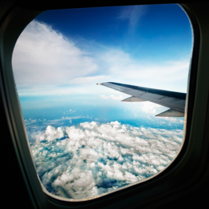 Porthole「Airplane flying above clouds, view from interior」:スマホ壁紙(17)