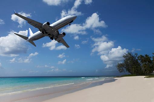 デジタル合成「Airplane flying over tropical beach」:スマホ壁紙(12)
