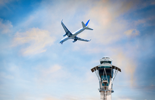 LAX Airport「Airplane flying over air traffic control tower」:スマホ壁紙(0)