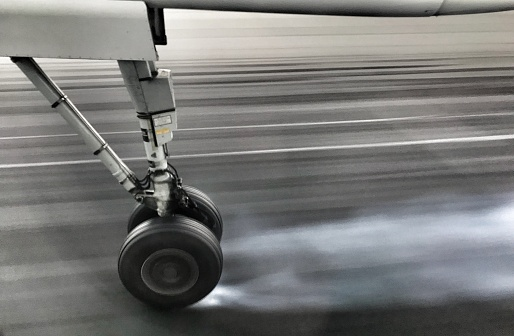 Taken on Mobile Device「Small airplane wheel on the airport runway.」:スマホ壁紙(11)