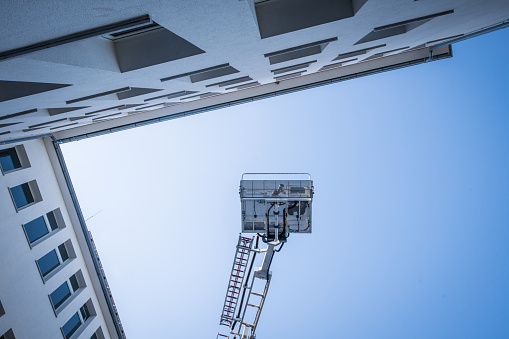 Emergency Services Occupation「Firefighter rescue basket truck lift high up in the air」:スマホ壁紙(17)