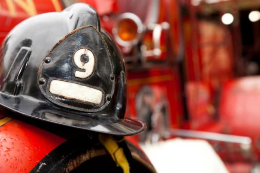 Emergency Services Occupation「Firefighter Helmet Resting on Firetruck」:スマホ壁紙(17)