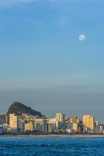 Growth「Full moon rising in sky above buildings」:スマホ壁紙(15)
