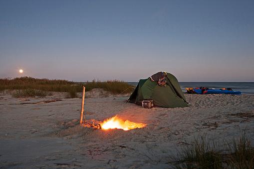 Charleston - South Carolina「A full moon rises over a beach campsite on Capers Island」:スマホ壁紙(3)