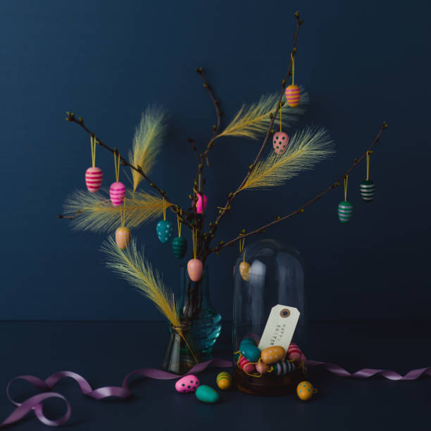 Easter still life with twigs and egg decorations with cruelty free artificial feathers on dark blue:スマホ壁紙(壁紙.com)