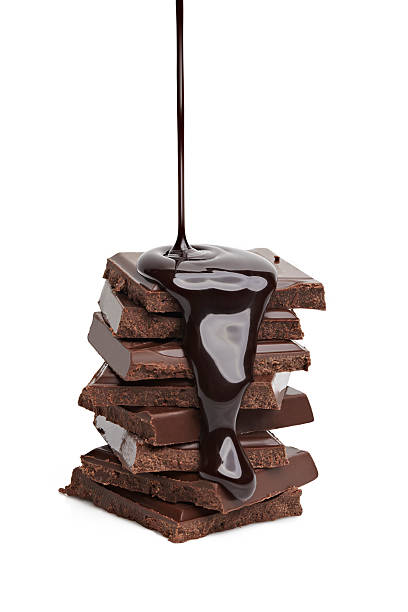 Liquid chocolate being poured on a stack of solid chocolate :スマホ壁紙(壁紙.com)