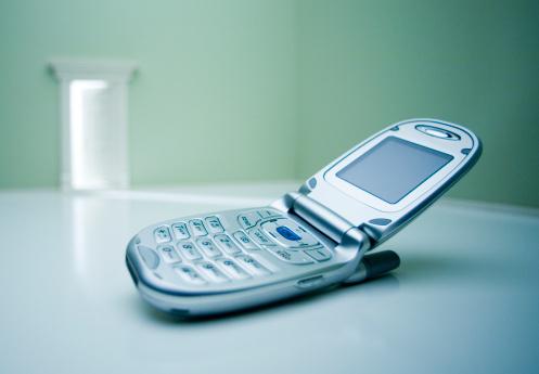 Image「Mobile phone on floor (focus on phone)」:スマホ壁紙(5)