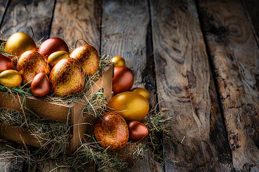 Easter Basket「Easter eggs on rustic wooden table. Copy space」:スマホ壁紙(8)