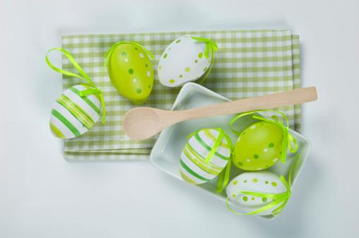 イースター「Easter eggs with napkin, wooden spoon on white background」:スマホ壁紙(5)