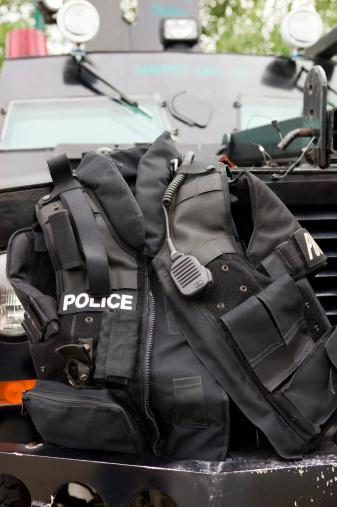 Bulletproof「Police vest sitting on bumper of armored vehicle」:スマホ壁紙(12)