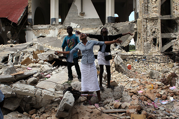 John Moore「Haiti Observes Three Days Of Mourning One Month After Earthquake Struck」:写真・画像(14)[壁紙.com]
