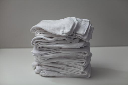 New Jersey「Stack of White tube socks on white table.」:スマホ壁紙(1)